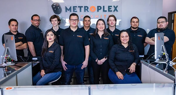 image of Metroplex staff in their storefront